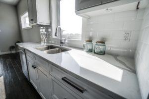 Hardwood Floors Neutral Counters and backsplash